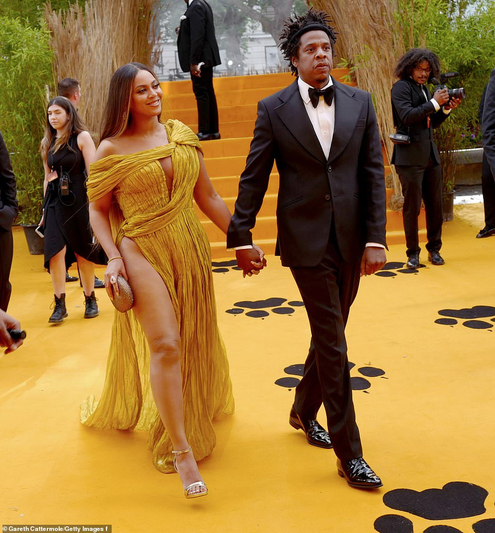 Photos: Beyonce commands attention in a gold asymmetric gown as she joins husband Jay-Z at London's premiere of The Lion King