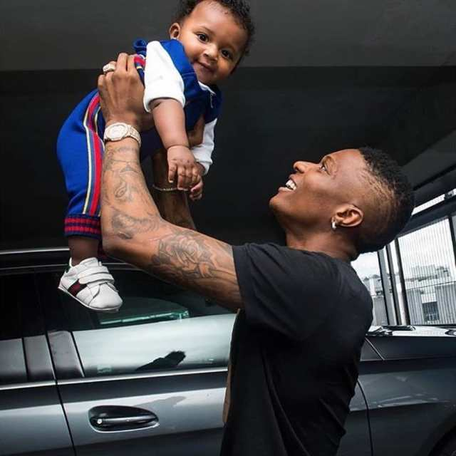 "Wizkid Reacts After Being Called ""Humble"" For Eating Pounded Yam With His Son, Zion"